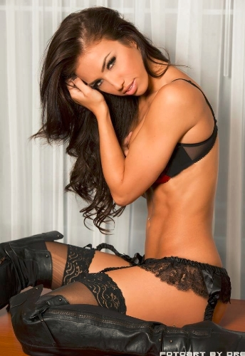 Bre Tiesi wearing lingerie which leaves little to the imagination, and sitting seductively while looking at the camera