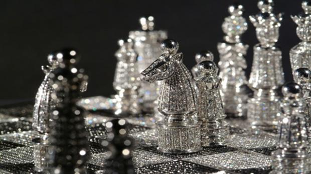 chess board with white diamond pieces versus black diamond pieces