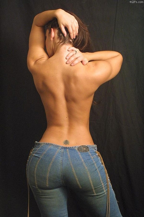 beautiful topless woman with her back to the camera shows off her bit butt