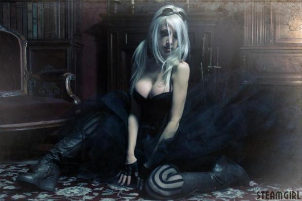 busty steampunk woman in striped tights and wearing a black burlesque dress sitting on the floor and looking away from the camera