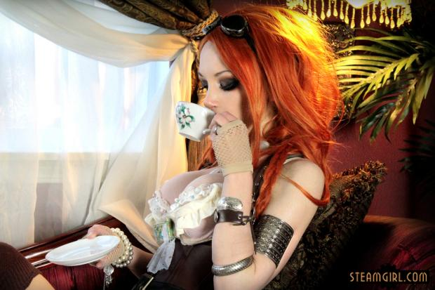 busty fire red haired steampunk woman wearing a white push up bra drinking tea seductively