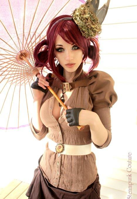 beautiful redheaded steampunk woman holding on to an umbrella. She is wearing a short brown skirt and a push up bra