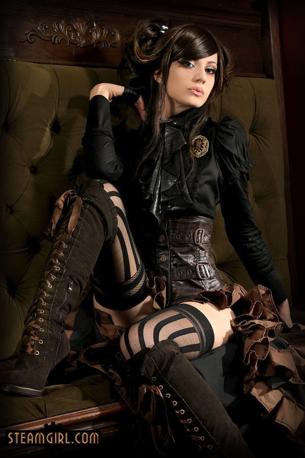 beautiful steampunk woman in all black looking seductively at camera